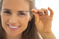 Young woman shaping eyebrows Stock Images