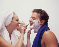 A young woman shaves her husband Royalty Free Stock Photo