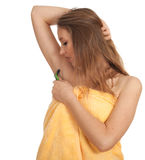 Young woman shaving underarm with razor Stock Images