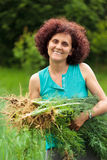Young woman with a sheaf of dill Royalty Free Stock Photos