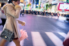 Young woman at the Shibuya Crossing in Tokyo. Stock Images