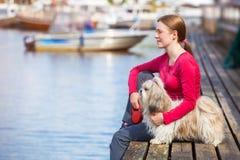 Young woman with shih-tzu dog stock photos