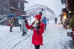 Young woman in Shirakawa-go village in winter, UNESCO world heritage sites, Japan Stock Photos