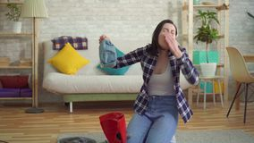 Young woman in a shirt allergic to dust from. A vacuum cleaner stock video footage
