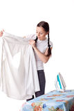 Young woman with shirt and iron. Stock Images