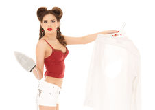 Young woman with shirt and iron. Stock Photo