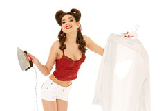 Young woman with shirt and iron. Royalty Free Stock Photography