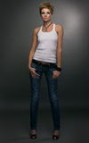 Young woman in shirt and jeans Stock Photos