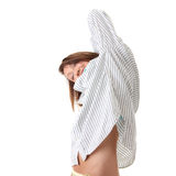Young woman in shirt, stretching arms Stock Images