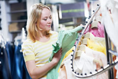 Young woman at shirts clothes shopping Stock Photography