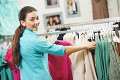 Young woman at shirts clothes shopping Stock Image