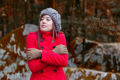 Young woman shivering with cold and embracing herself Royalty Free Stock Photography