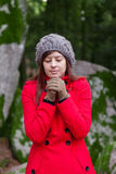 Young woman shivering with cold on a forest Stock Photo