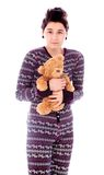 Young woman shivering and holding teddy bear Stock Photography