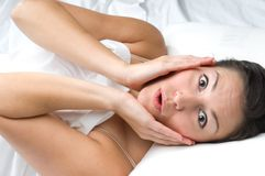 Young woman with a shocked exxpression Royalty Free Stock Photos
