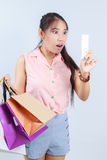 Young woman shocking. After checking over the receipt in her hands and spending too much Royalty Free Stock Photo