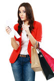 Young woman shocking. After checking over the receipt in her hands and spending too much Stock Image