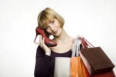 Young woman with shoe and bags Stock Photography