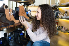 Young woman in a shoe store Stock Photo