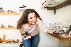 Young woman in a shoe store Stock Image