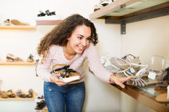 Young woman in a shoe store Royalty Free Stock Photo