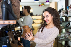 Young woman in a shoe store Royalty Free Stock Image