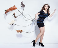Young woman with shoes. Young woman with many shoes royalty free stock photos