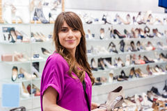 Young woman in a shoes shop Royalty Free Stock Image