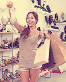 Young woman in shoes store Royalty Free Stock Photos