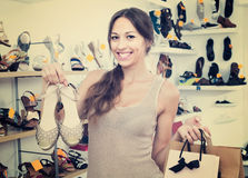 Young woman in shoes store Royalty Free Stock Photography