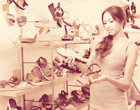 Young woman in shoes store Stock Photo