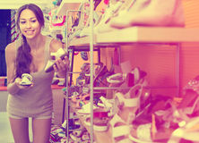 Young woman in shoes store Royalty Free Stock Images