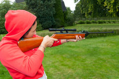Young woman shooting with airgun Royalty Free Stock Photos