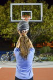 Young woman shooting at the basket royalty free stock photo