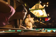 Young Woman Shooting Pool Stock Image