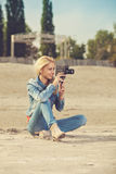 Young woman shooting video with old analog camera Royalty Free Stock Photos