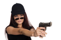 Young woman shoots a gun Royalty Free Stock Photography