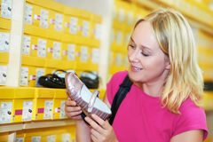 Young woman at shop Royalty Free Stock Images