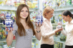 Young woman in shop Stock Images