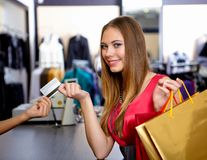 Young woman in a shop buying clothes Stock Photography