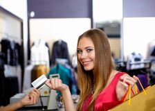 Young woman in a shop buying clothes Royalty Free Stock Photos