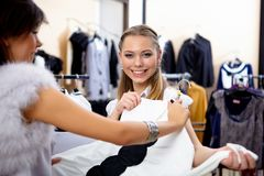 Young woman in a shop buying clothes Stock Images