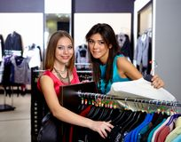 Young woman in a shop buying clothes Royalty Free Stock Image