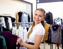 Young woman in a shop buying clothes Royalty Free Stock Photography