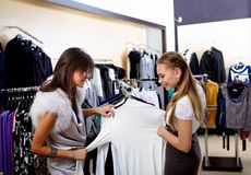 Young woman in a shop buying clothes Royalty Free Stock Photo