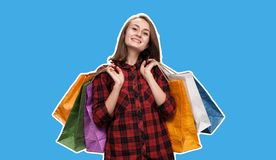 Young woman with shoping bags. Happy young woman with shoping bags. Magazine style collage with copy space and blue background royalty free stock photos