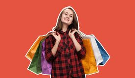 Young woman with shoping bags. Happy young woman with shoping bags. Magazine style collage with copy space and trendy living coral color background royalty free stock images