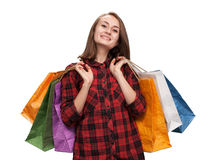 Young woman with shoping bags. Isolated on white background with copy-space royalty free stock photography