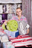 Young woman shopper buying new blanket and coverlet Stock Photo