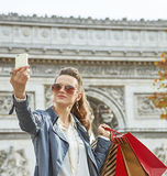 Young woman shopper in Paris, France taking selfie with phone Royalty Free Stock Photo